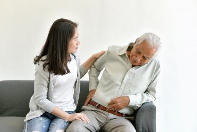 nurse worried to senior man having an arthritis, joint pain problem